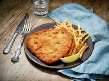 Weiner Schnitzel with fried Potatoes royalty free stock images