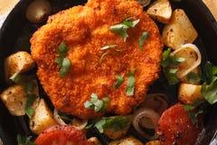 Weiner schnitzel, fried potatoes in a pan closeup. horizontal to Stock Image
