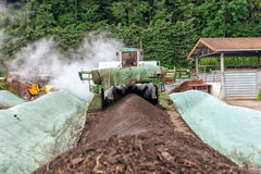 WEINFELDEN, SWITZERLAND - JUNE 22 2010: Aerating compost in indu. Strial environment with a huge special machine Royalty Free Stock Photos