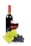 Weinflasche, -glas und -trauben lizenzfreies stockfoto