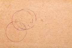 Weinflecke auf braunem Papier Lizenzfreies Stockfoto