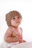 Weinig baby die zijn maag clutching stock foto's