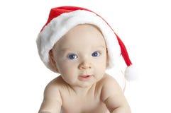 Weinig baby met santashoed luid lachen uit stock fotografie