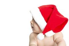 Weinig baby met santashoed luid lachen uit royalty-vrije stock fotografie