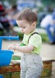 Weinig babyjongen op speelplaatsportret stock afbeelding
