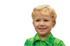 Weinig blonde jongen op een wit Stock Afbeeldingen