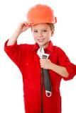 Weinig bouwer in helm met moersleutel stock foto's