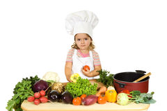 Weinig chef-kok met groenten Royalty-vrije Stock Foto