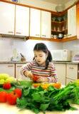 Weinig chef-kok op het werk Royalty-vrije Stock Afbeeldingen
