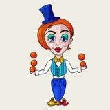 Weinig clownmeisje het spelen sinaasappelen Stock Afbeelding