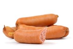 Weinig geheel en één - half - gegeten worsten Stock Foto's