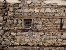 Weinig gekooid venster stock afbeelding