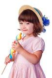 Weinig glimlachend meisje met lolly Stock Foto