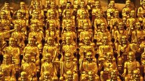 Weinig gouden Buddhas stock afbeelding