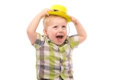 Weinig Grappige jongen in overhemd en grappige hoed Royalty-vrije Stock Afbeelding