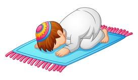 Weinig jong geitjeprostratie voor het bidden van Moslim royalty-vrije illustratie