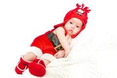 Weinig jongen in de hoed van de Kerstman Royalty-vrije Stock Afbeeldingen