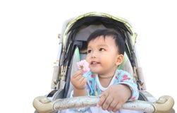 Weinig jongen in de kinderwagen en holding bloeien Concept jong geitje Stock Afbeeldingen
