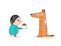 Weinig jongen die een hond voeden Stock Foto's