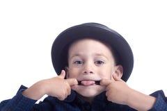 Weinig jongen die gezichten maakt Royalty-vrije Stock Afbeeldingen