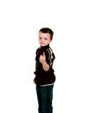 Weinig jongen die met vinger benadrukt Stock Foto's