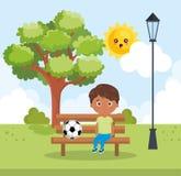 Weinig jongen die op het park spelen stock illustratie