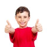 Weinig jongen die twee duimen tonen royalty-vrije stock foto