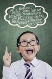 Weinig jongen die vreemde taal leren Royalty-vrije Stock Afbeelding