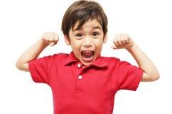 Weinig jongen die zijn spieren tonen royalty-vrije stock afbeelding