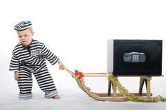 Weinig jongen in diefuitrusting Stock Foto