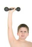 Weinig jongen doet gymnastiek stock afbeeldingen