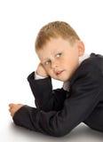 Weinig jongen in een kostuum stock foto's