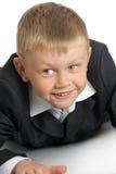 Weinig jongen in een kostuum stock afbeelding