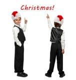 Weinig jongen in een smoking en in Santa Claus-Kerstmisrood Stock Fotografie