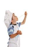 Weinig jongen eet spagetti Stock Foto