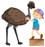 Weinig jongen en leuke emoevogel royalty-vrije illustratie