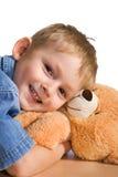Weinig jongen en teddybeer Royalty-vrije Stock Afbeeldingen