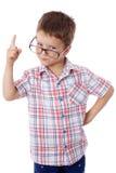 Weinig jongen in glazen met het richten van hand Royalty-vrije Stock Foto's