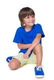 Weinig jongen in het blauwe overhemd Royalty-vrije Stock Afbeeldingen