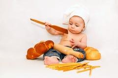 Weinig jongen in het kokkostuum Stock Afbeeldingen