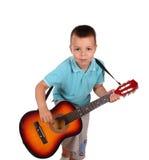 Weinig jongen het spelen gitaar Royalty-vrije Stock Fotografie