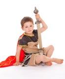 Weinig jongen kleedde zich als ridder Stock Foto