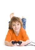 Weinig jongen met consolecontrolemechanisme Stock Afbeelding