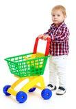 Weinig jongen met een stuk speelgoed vrachtwagen Royalty-vrije Stock Foto's