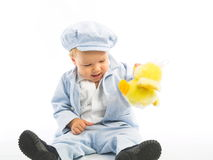 Weinig jongen met geel stuk speelgoed Stock Foto