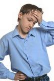 Weinig jongen met hoofdpijn Stock Afbeelding
