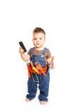 Weinig jongen met hulpmiddelen en mobiele telefoon op een witte achtergrond Royalty-vrije Stock Foto