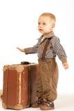 Weinig jongen met koffer Stock Afbeelding