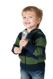 Weinig jongen met mic stock foto