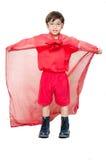 Weinig jongen is omhoog gekleed als superhero het vliegen royalty-vrije stock foto